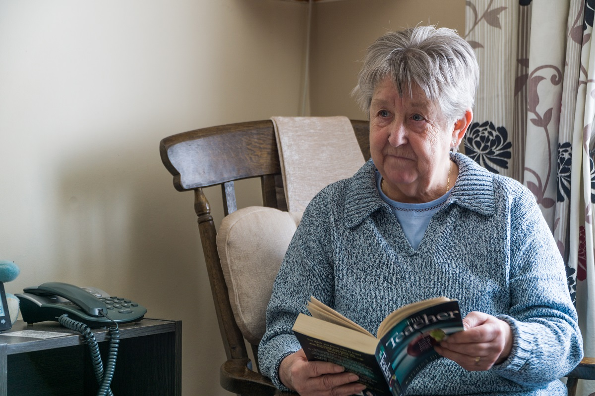 Old person reading a book